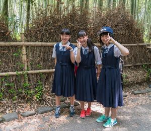 Image is of three female Japanese students.