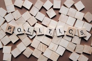 Image is of scrabble tiles spelling the word Politics.