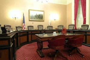 Image is of a committee meeting room in the California Capital Building.