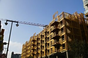 Image is of an apartment complex under construction.