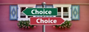 "Image is of one green sign and one red sign, pointing in different directions, which say ""choice"" on them."