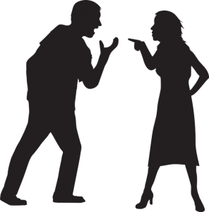 Image is of a man and woman arguing in silhouette.