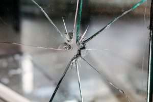 Image is a close up of a broken window.