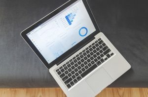 Image is an open laptop with a graph and stats on it.