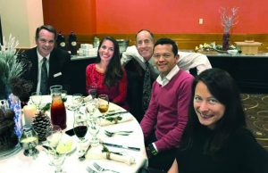 Image is picture of Shenshu Marathon runners at holiday dinner party.