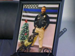 Image is a picture of Ronil Singh that was displayed at his memorial.