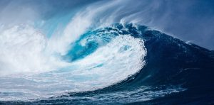 Image is a huge ocean wave breaking.