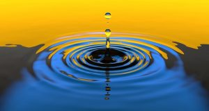 Image is a drop of water in a pool creating ripples.