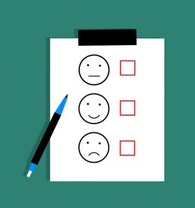 Image is a sheet of paper with a smiley face, neutral face, and a frowny face on it, each with a check box next to it.