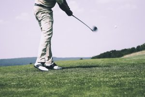 Image is a man playing golf.