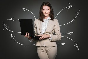 Image is a property manager holding a computer.