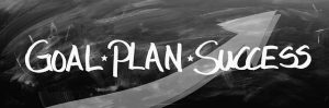 Image is the words Goal, Plan, Success on a chalkboard.