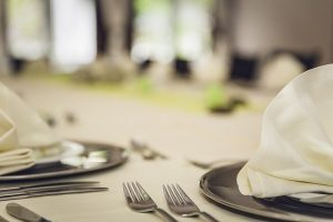 Image is a close up of a table set for a nice meal.