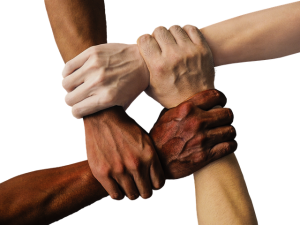 Image is four people of different nationalities gripping wrists to form a square.